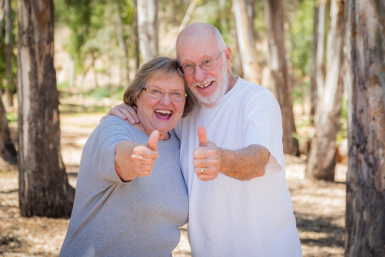 Couple giving thumbs up